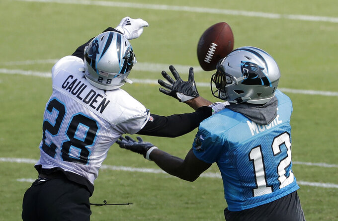 Carolina Panthers' DJ Moore (12) battles Rashaan Gaulden (28) for a pass during practice at the NFL football team's training camp in Spartanburg, N.C., Friday, July 26, 2019. (AP Photo/Chuck Burton)