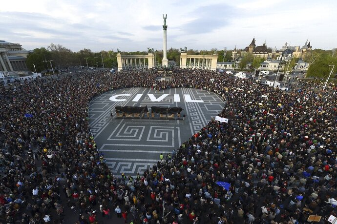 FILE - In this April 12, 2017 photo people gather to protest against then planned new NGO and CEU laws, at the Heroes Square in Budapest. The European Union's Court of Justice says that restrictions imposed by Hungary on the foreign funding of non-governmental organizations does not comply with EU law. (Zoltan Balogh/MTI via AP,file)