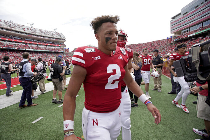 FILE - In this Aug. 31, 2019, file photo, Nebraska quarterback Adrian Martinez (2) walks off the field following a 35-21 win against against South Alabama in an NCAA college football game in Lincoln, Neb. The co-No. 25 Cornhuskers are revved up to play their old Big Eight/Big 12 rivals after a sluggish offensive performance against South Alabama. Martinez must be much better if Nebraska is going to win a road game for the first time under second-year coach Scott Frost. (AP Photo/Nati Harnik, File)