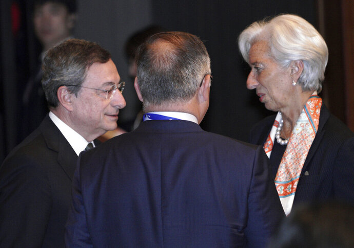 International Monetary Fund (IMF) Managing Director Christine Lagarde, right, and European Central Bank (ECB) President Mario Draghi, left, speak prior to G20 Finance Ministers' and Central Bank Governors' Meeting Saturday, June 8, 2019, in Fukuoka, western Japan. (AP Photo/Eugene Hoshiko, Pool)