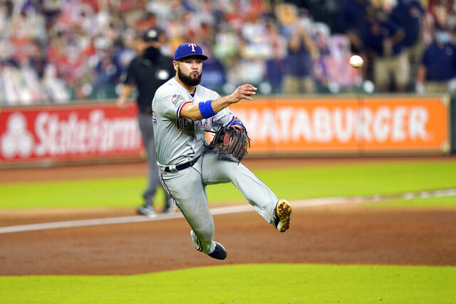 Texas Rangers third baseman Isiah Kiner-Falefa throws to first for the out after fielding a ground ball by Houston Astros' Alex Bregman during the third inning of a baseball game Thursday, Sept. 17, 2020, in Houston. (AP Photo/David J. Phillip)