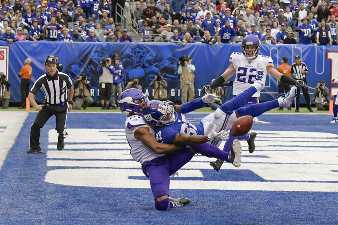 Minnesota Vikings cornerback Mike Hughes (21) breaks up a pass in the end zone intended for New York Giants wide receiver Sterling Shepard (87) during the fourth quarter of an NFL football game, Sunday, Oct. 6, 2019, in East Rutherford, N.J. (AP Photo/Bill Kostroun)