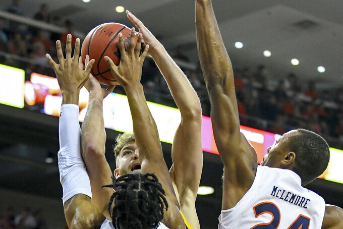 Auburn forward Isaac Okoro (23) and Auburn forward Anfernee McLemore (24) block a shot by Lipscomb forward Parker Hazen (13) during the first half of an NCAA college basketball game Sunday, Dec. 29, 2019, in Auburn, Ala. (AP Photo/Julie Bennett)