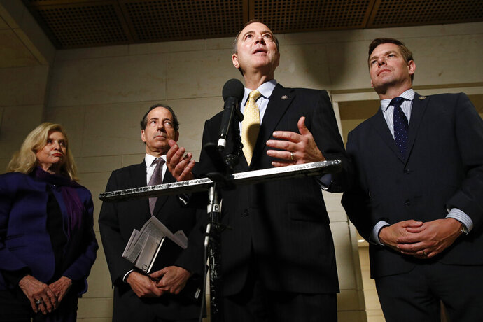 Rep. Adam Schiff, D-Calif., second from right, speaks with members of the media after former deputy national security adviser Charles Kupperman signaled that he would not appear as scheduled for a closed door meeting to testify as part of the House impeachment inquiry into President Donald Trump, Monday, Oct. 28, 2019, on Capitol Hill in Washington. Standing with Schiff are Carolyn Maloney, D-N.Y., from left, Rep. Jamie Raskin, D-Md., and Rep. Eric Swalwell, D-Calif. (AP Photo/Patrick Semansky)