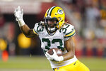 Green Bay Packers running back Aaron Jones (33) runs against the San Francisco 49ers during the second half of the NFL NFC Championship football game Sunday, Jan. 19, 2020, in Santa Clara, Calif. (AP Photo/Tony Avelar)