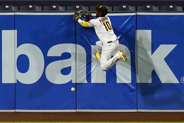 San Diego Padres left fielder Jurickson Profar can't make the catch off an RBI double by Houston Astros' Myles Straw during the sixth inning of a baseball game Friday, Aug. 21, 2020, in San Diego. (AP Photo/Gregory Bull)