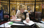 State Sen. Janet Howell, D-Fairfax, chair of the Senate Finance and Appropriations Committee, looks over papers at her desk during debate on the budget bill during the floor session of the Senate inside the Virginia State Capitol in Richmond, Va., Wednesday, Aug. 4, 2021, on the third day of the General Assembly Special Session. (Bob Brown/Richmond Times-Dispatch via AP)