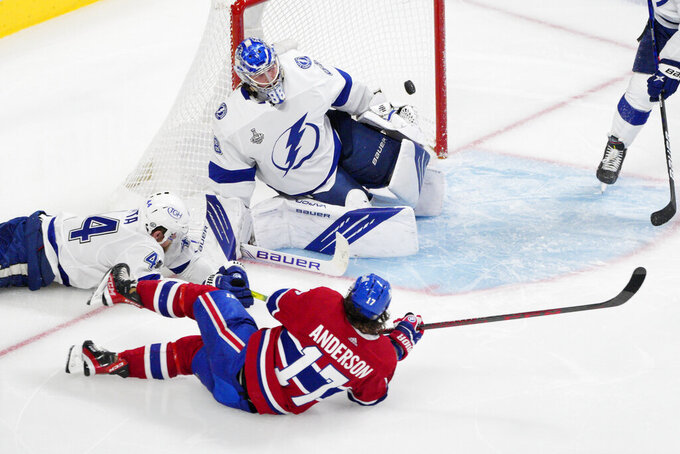 Montreal Canadiens right wing Josh Anderson (17) scores past Tampa Bay Lightning goaltender Andrei Vasilevskiy (88) as Lightning defenseman Jan Rutta (44) defends during overtime of Game 4 of the NHL hockey Stanley Cup final in Montreal, Monday, July 5, 2021. (Paul Chiasson/The Canadian Press via AP)