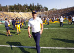 California head coach Justin Wilcox runs off the field following his team's 24-17 victory over North Carolina in an NCAA college football game, Saturday, Sept. 1, 2018, in Berkeley, Calif. (AP Photo/D. Ross Cameron)