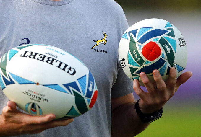 FILE - In this file photo dated Wednesday, Oct. 30, 2019, South Africa's Springbok rugby coach during a training session in Urayasu, Japan.  Three members of the Springboks rugby squad have tested positive for coronavirus, forcing the world champions to cancel a training session and put all their players in isolation at the team camp in Johannesburg, national body SA Rugby said on Sunday June 27, 2021.(AP Photo/Christophe Ena, FILE)