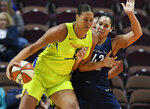 FILE - In this May 8, 2018, file photo, Dallas Wings' Liz Cambage, left, drives against Connecticut Sun's Brionna Jones during a preseason WNBA basketball game in Uncasville, Conn. A person familiar with the situation tells The Associated Press that the Dallas Wings have traded Liz Cambage to Las Vegas for Moriah Jefferson, Isabelle Harrison and the Aces' first two picks in 2020.  The person spoke on condition of anonymity Thursday, May 16, 2019, because the deal hasn't been announced. (AP Photo/Jessica Hill, File)