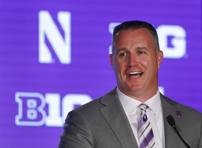 FILE - Northwestern head coach Pat Fitzgerald responds to a question during Big Ten Conference NCAA college football media days in Chicago, in this Friday, July 19, 2019, file photo. Northwestern and coach Pat Fitzgerald have agreed to a new contract through the 2030 season. The 46-year-old Fitzgerald is by far the program's winningest coach with a 106-81 record since he took over at his alma mater in 2006 following Randy Walker's unexpected death. (AP Photo/Charles Rex Arbogast, File)