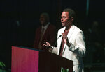 1993 Heisman quarterback Charlie Ward eulogizes longtime Florida State University football coach Bobby Bowden as Bowden lies in repose at the Tucker Civic Center during a public celebration of life, Saturday, Aug. 14, 2021, in Tallahassee, Fla. Bowden became the FSU football coach in 1976, transforming the program into one of the best in the country. He coached FSU to national championships in 1993 and 1999. Bowden was 91. (AP Photo/Mark Wallheiser)