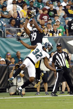 Pittsburgh Steelers' JuJu Smith-Schuster (19) catches a pass above Philadelphia Eagles' Rasul Douglas (32) during the first half of a preseason NFL football game Thursday, Aug. 9, 2018, in Philadelphia. (AP Photo/Michael Perez)