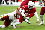 Arizona Cardinals quarterback Kyler Murray (1) is pulled down by Washington Football Team inside linebacker Jon Bostic (53) during the second half of an NFL football game, Sunday, Sept. 20, 2020, in Glendale, Ariz. (AP Photo/Darryl Webb)