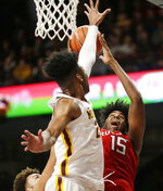Rutgers center Myles Johnson (15) shoots over Minnesota guard Marcus Carr (2) during the second half of an NCAA college basketball game Saturday, Jan. 12, 2019, in Minneapolis. Minnesota defeated Rutgers 88-70. (AP Photo/Andy Clayton-King)