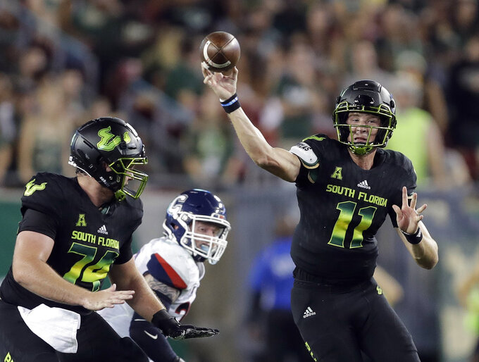 South Florida quarterback Blake Barnett (11) fires a pass against Connecticut during the first half of an NCAA college football game Saturday, Oct. 20, 2018, in Tampa, Fla. (AP Photo/Chris O'Meara)