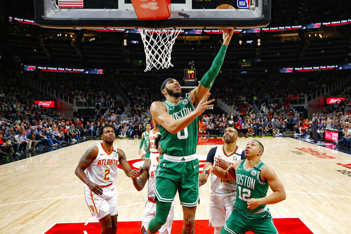 Boston Celtics forward Jayson Tatum (0) goes up for the shot in the second half of an NBA basketball game against the Atlanta Hawks on Monday, Feb. 3, 2020, in Atlanta. (AP Photo/Todd Kirkland)