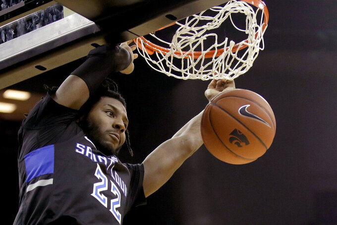 Saint Louis' Terrence Hargrove Jr. dunks during the second half of an NCAA college basketball game against Kansas State, Saturday, Dec. 21, 2019, in Kansas City, Mo. (AP Photo/Charlie Riedel)