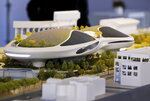 An architectural model of the Lucas Museum of Narrative Art iconic building designed by Ma Yansong of MAD Architects is displayed in Los Angeles Wednesday, March 14, 2018. The institution, scheduled to open in 2021, is envisioned as not just a repository for