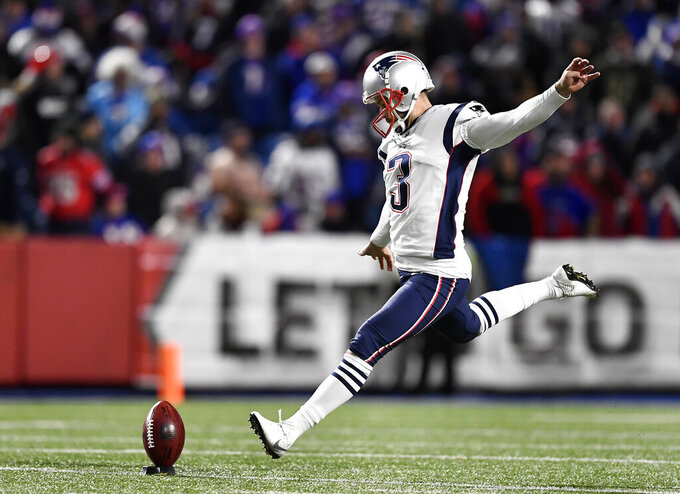 FILE - In this Oct. 29, 2018, file photo, New England Patriots kicker Stephen Gostkowski winds up to kickoff in the second half of an NFL football game against the Buffalo Bills in Orchard Park, N.Y. Only two players on the Patriots 2018 roster, Tom Brady and Stephen Gostkowski, were around for each of their previous five Super Bowl appearances (2007, 2011, 2014, 2016, 2017).  With his sixth Super Bowl appearance, Gostkowski will tie Mike Lodish for the second-most played, behind Brady's nine. (AP Photo/Adrian Kraus, File)