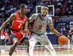 Mississippi guard Devontae Shuler (2) dribbles against Georgia's Jordan Harris (2) during an NCAA college basketball game in Oxford, Miss., Saturday, Feb. 23, 2019. (Bruce Newman/The Oxford Eagle via AP)