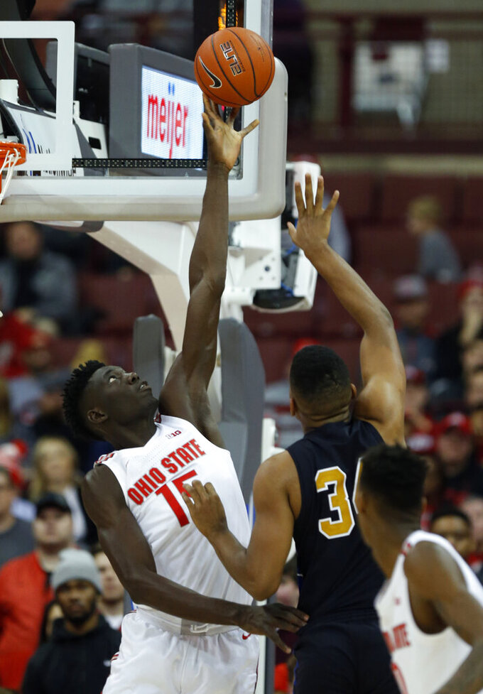 Ohio State center Ibrahima Diallo, left, blocks a shot by Purdue Fort Wayne forward Cameron Benford during the second half of an NCAA college basketball game in Columbus, Ohio, Friday, Nov. 22, 2019. Ohio State won 85-46 (AP Photo/Paul Vernon)