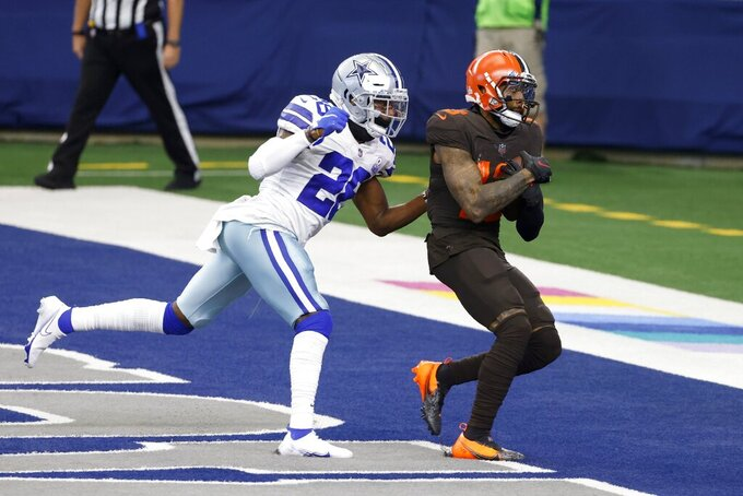 Dallas Cowboys cornerback Daryl Worley (28) defends as Cleveland Browns wide receiver Odell Beckham Jr. (13) catches a touchdown pass in the first half of an NFL football game in Arlington, Texas, Sunday, Oct. 4, 2020. (AP Photo/Ron Jenkins)
