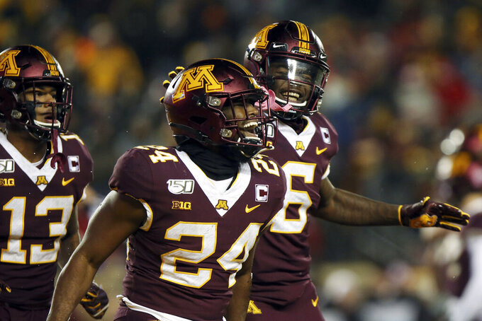 Minnesota running back Mohamed Ibrahim, center, reacts with teammates after scoring a touchdown against Nebraska during an NCAA college football game Saturday, Oct. 12, 2019, in Minneapolis. (AP Photo/Stacy Bengs)