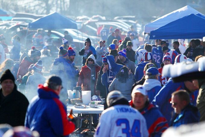 FILE - Fans arrive to tailgate before an NFL football game between the Buffalo Bills and the Jacksonville Jaguars in Orchard Park, N.Y., in this Sunday, Nov. 27, 2016, file photo. Testing will replace tailgating in the Bills Stadium's expansive parking lot starting Wednesday, when some 6,700 fans will be required to be tested for the coronavirus in order to be allowed to attend Buffalo's AFC wild-card playoff game against the Indianapolis Colts on Saturday. (AP Photo/Bill Wippert, File)