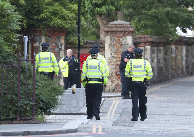Police arrive at Forbury Gardens in the town centre of Reading, England, where they are responding to a