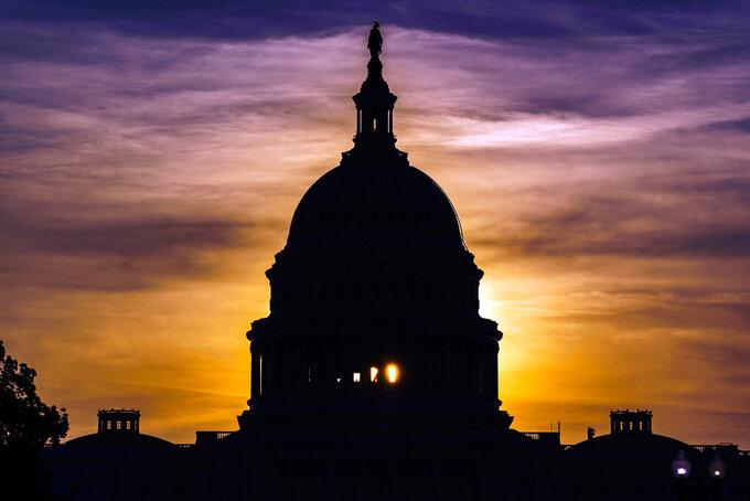 The sun rises behind the Capitol in Washington, Wednesday, Sept. 15, 2021. (AP Photo/J. Scott Applewhite)