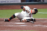 San Francisco Giants' Donovan Solano grimaces after being hit by a pitch against the Colorado Rockies during the seventh inning of a baseball game on Monday, Sept. 21, 2020, in San Francisco. (AP Photo/Tony Avelar)