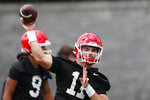 FILE - In this Aug. 2, 2019, file photo, Georgia quarterback Jake Fromm throws a pass during the team's first scheduled NCAA college football practice in Athens, Ga. Georgia  fully expects to contend for a national championship. Now, the Bulldogs have to show they can finish the job after coming tantalizingly close the last two seasons. (AP Photo/John Bazemore, File)