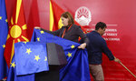 Government employees prepare the flags of European Union and North Macedonia prior a news conference of European Parliament President David Sassoli and North Macedonia's Prime Minister Zoran Zaev, in the government building in Skopje, North Macedonia, Monday, Nov. 4, 2019. (AP Photo/Boris Grdanoski)