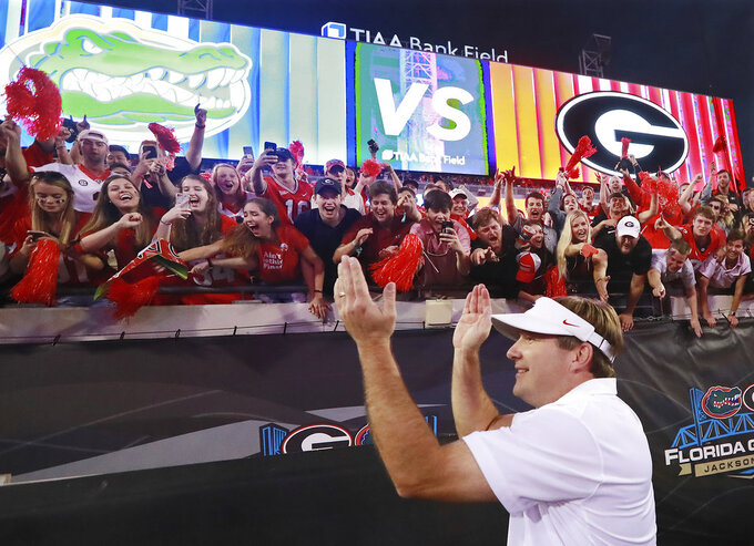Georgia head coach Kirby Smart celebrates a 36-17 victory over Florida with the fans after their NCAA college football game, Saturday, Oct 27, 2018, in Jacksonville, Fla. (Curtis Compton/Atlanta Journal-Constitution via AP)