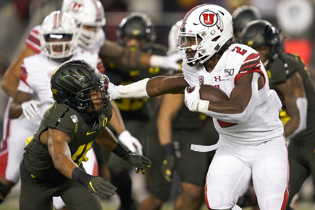 Utah running back Zack Moss (2) stiff-arms Oregon cornerback Thomas Graham Jr. (4) during the first half of the Pac-12 Conference championship NCAA college football game in Santa Clara, Calif., Friday, Dec. 6, 2018. (AP Photo/Tony Avelar)