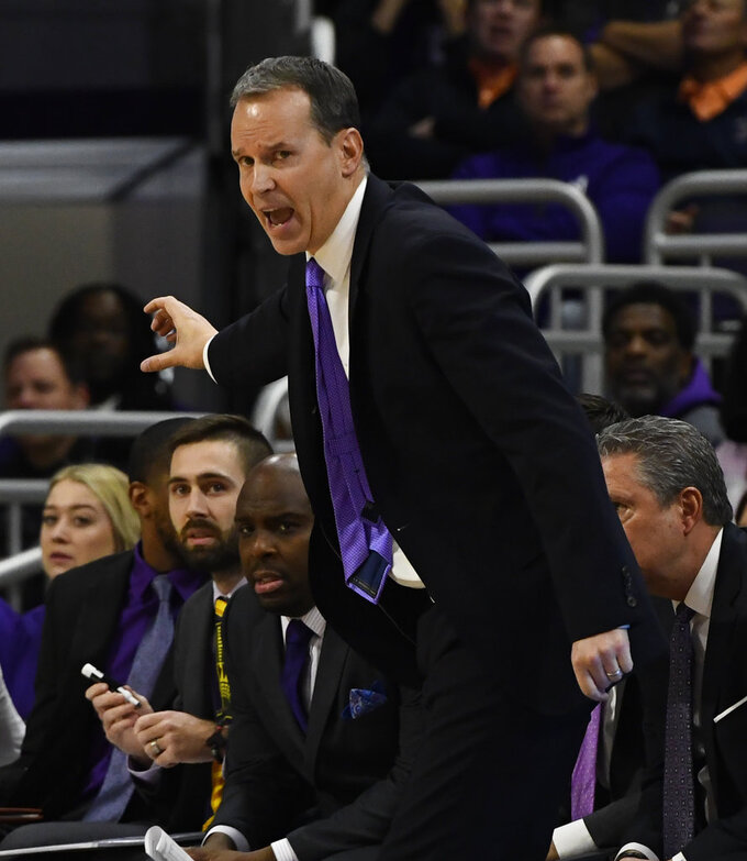 Northwestern head coach Chris Collins directs his team during the first half of an NCAA college basketball game against Illinois, Sunday, Jan. 6, 2019, in Evanston, Ill. (AP Photo/Matt Marton)