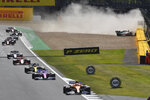 Haas driver Kevin Magnussen of Denmark crashes during the British Formula One Grand Prix at the Silverstone racetrack, Silverstone, England, Sunday, Aug. 2, 2020. (Ben Stansall/Pool via AP)