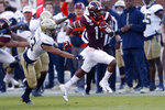 Virginia Tech wide receiver Tre Turner (11) runs for a first down against Georgia Tech defensive back Avery Showell (13) in the first half of an NCAA football game Saturday, Nov. 16, 2019, in Atlanta. (AP Photo/John Bazemore)
