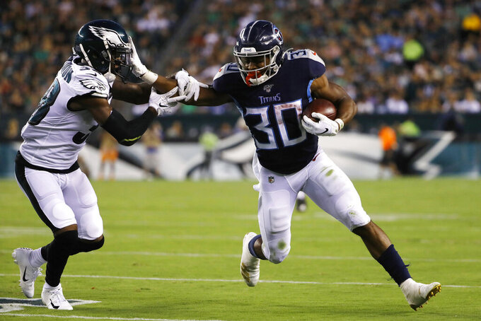 Tennessee Titans' Jeremy McNichols, right, shoves Philadelphia Eagles' Jeremiah McKinnon during the first half of a preseason NFL football game Thursday, Aug. 8, 2019, in Philadelphia. (AP Photo/Matt Rourke)