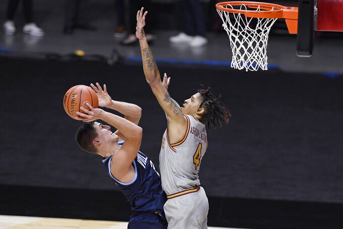 Villanova's Collin Gillespie shoots as Villanova's Chris Arcidiacono, right, defends during the first half of an NCAA college basketball game Wednesday, Nov. 25, 2020, in Uncasville, Conn. (AP Photo/Jessica Hill)