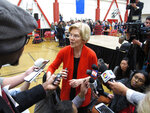 Sen. Elizabeth Warren, D-Mass., talks to reporters after a speech in a high school gymnasium in Reno, Nev., Saturday, April 6, 2019. Sen. Warren blasted President Trump's economic and environmental policies and touted her plan to invest $500 billion over the next 10 years to build, preserve and rehabilitate affordable housing units for low-income families. Warren said she would pay for it by returning the estate tax thresholds to where they were during President George W. Bush's administration and imposing a new