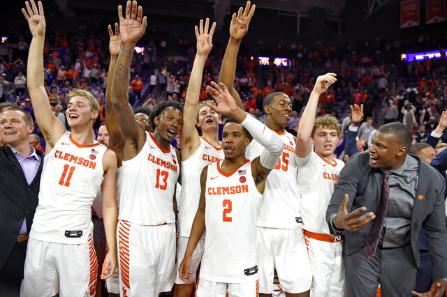 Clemson's Tevin Mack (13) and teammates celebrate after an NCAA college basketball game against Duke Tuesday, Jan. 14, 2020, in Clemson, S.C. Clemson won 79-72. (AP Photo/Richard Shiro)
