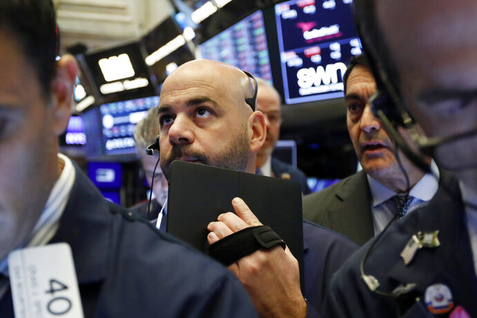 FILE - In this May 9, 2019, file photo trader Fred DeMarco works on the floor of the New York Stock Exchange. The U.S. stock market opens at 9:30 a.m. EDT on Thursday, May 16. (AP Photo/Richard Drew, File)