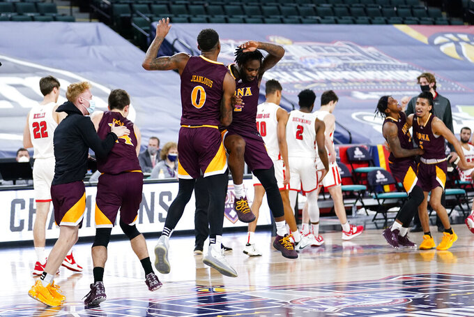 Iona's Asante Gist, right, and Berrick JeanLouis celebrate after winning an NCAA college basketball game against Fairfield during the finals of the Metro Atlantic Athletic Conference tournament, Saturday, March 13, 2021, in Atlantic City, N.J. (AP Photo/Matt Slocum)