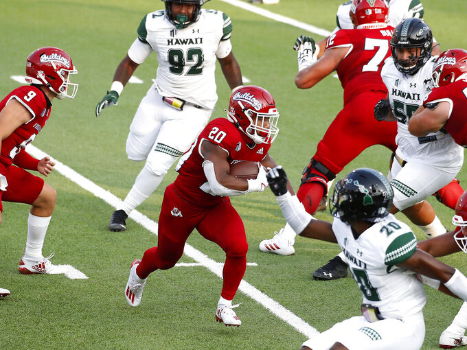 Fresno State running back Ronnie Rivers, center, looks for room to run against Hawaii during the first half of an NCAA college football game in Fresno, Calif., Saturday, Oct. 24, 2020. (AP Photo/Gary Kazanjian)