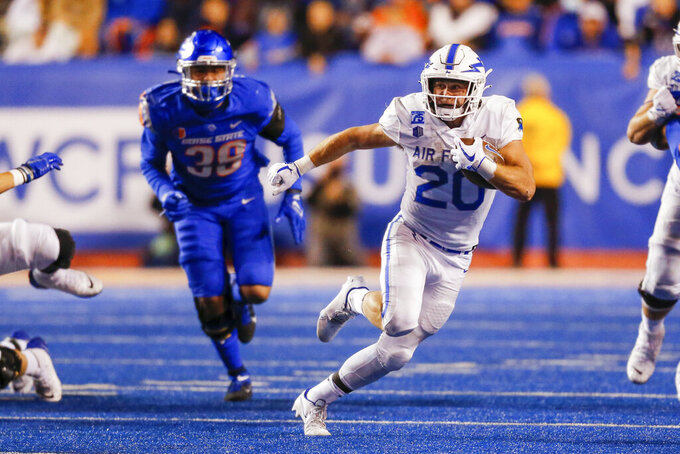 Air Force running back Brad Roberts (20) runs with the ball against Boise State during the second half of an NCAA college football game Saturday, Oct. 16, 2021, in Boise, Idaho. Air Force won 24-17. (AP Photo/Steve Conner)