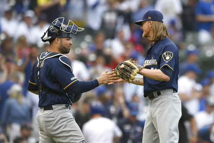Milwaukee Brewers closing pitcher Josh Hader right, celebrates with catcher Manny Pina left, after defeating the Chicago Cubs 2-0 in a baseball game Saturday, Aug 31, 2019, in Chicago. (AP Photo/Paul Beaty)
