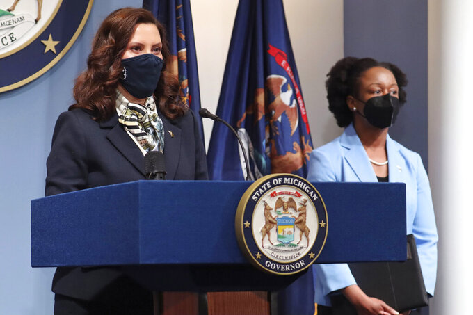 In this photo provided by the Michigan Office of the Governor, Gov. Gretchen Whitmer addresses the state during a speech, Wednesday, May 12, 2021, in Lansing, Mich. Michigan health officials are urging primary care physicians to enroll to administer COVID-19 vaccines, as the state prepares to quickly begin vaccinating 12- to 15-year-olds following U.S. authorization. The push to make doses available in physicians' offices will complement the state's focus on taking mobile clinics to places such as churches, and vaccinating people who are homebound. (Michigan Office of the Governor via AP)